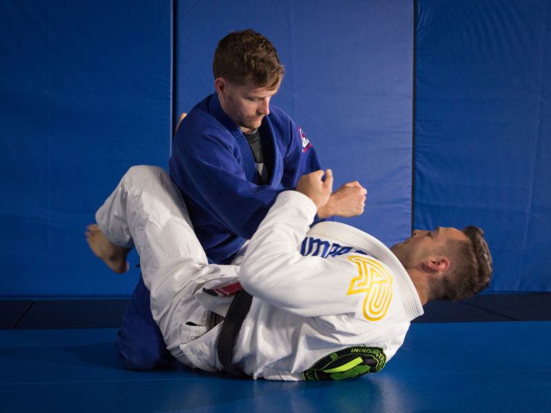 two men practicing Brazilian Jiu Jitsu