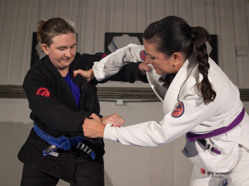 two women practicing Brazilian Jiu Jitsu