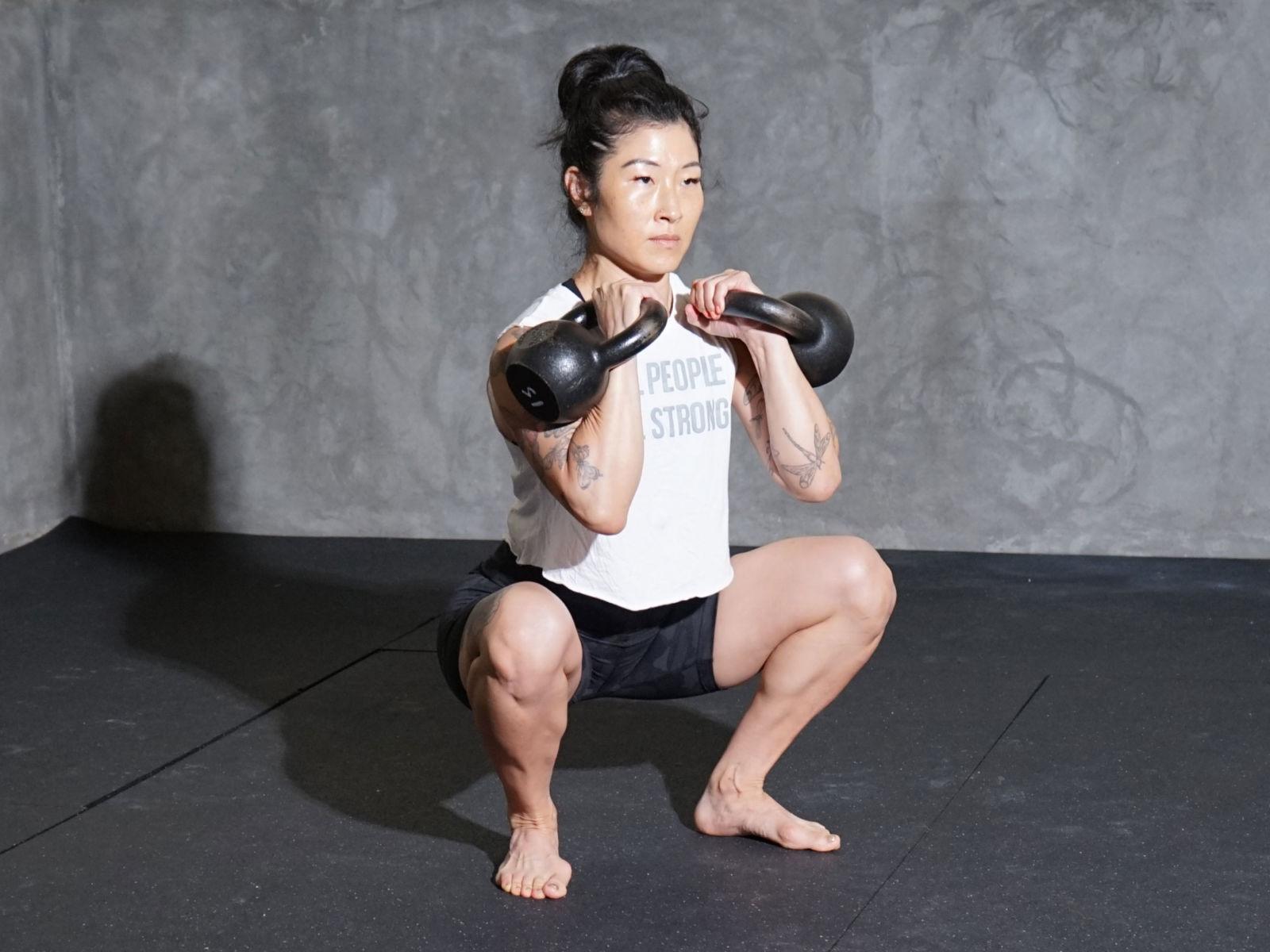 woman doing kettlebell squat