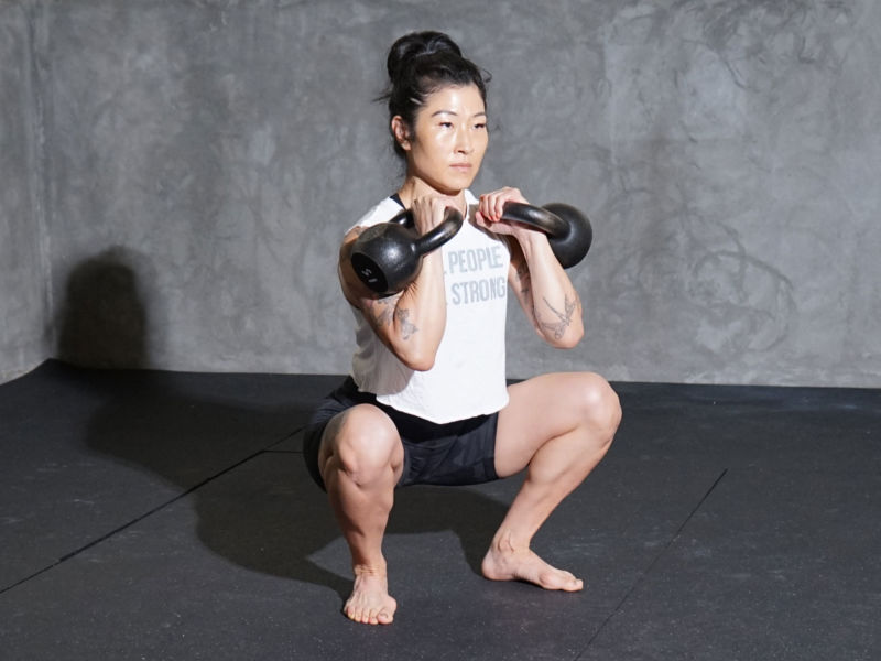 woman doing kettlebell squat
