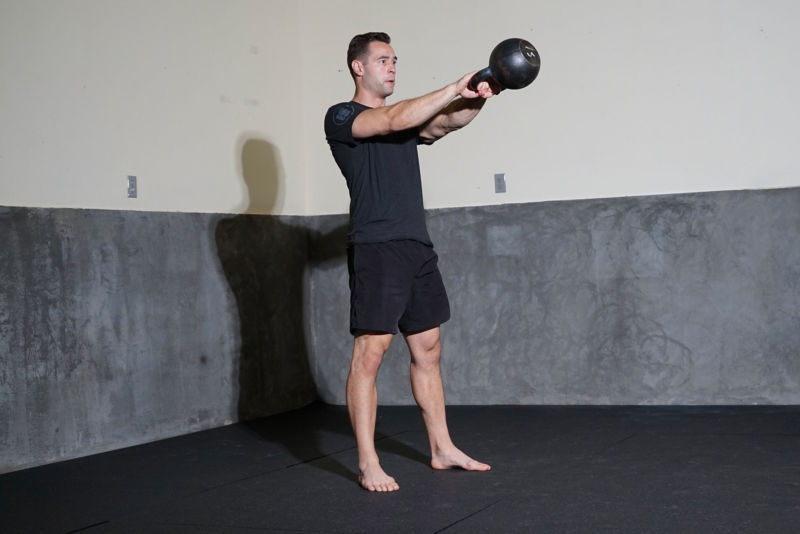 Man holding kettlebell in the air