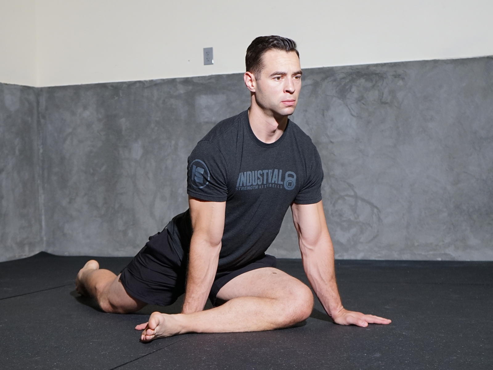 Man stretching hip on floor