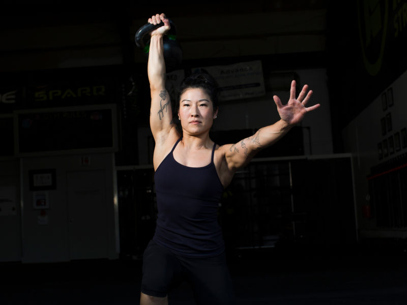 Mira Gracia doing a single military press with a kettlebell