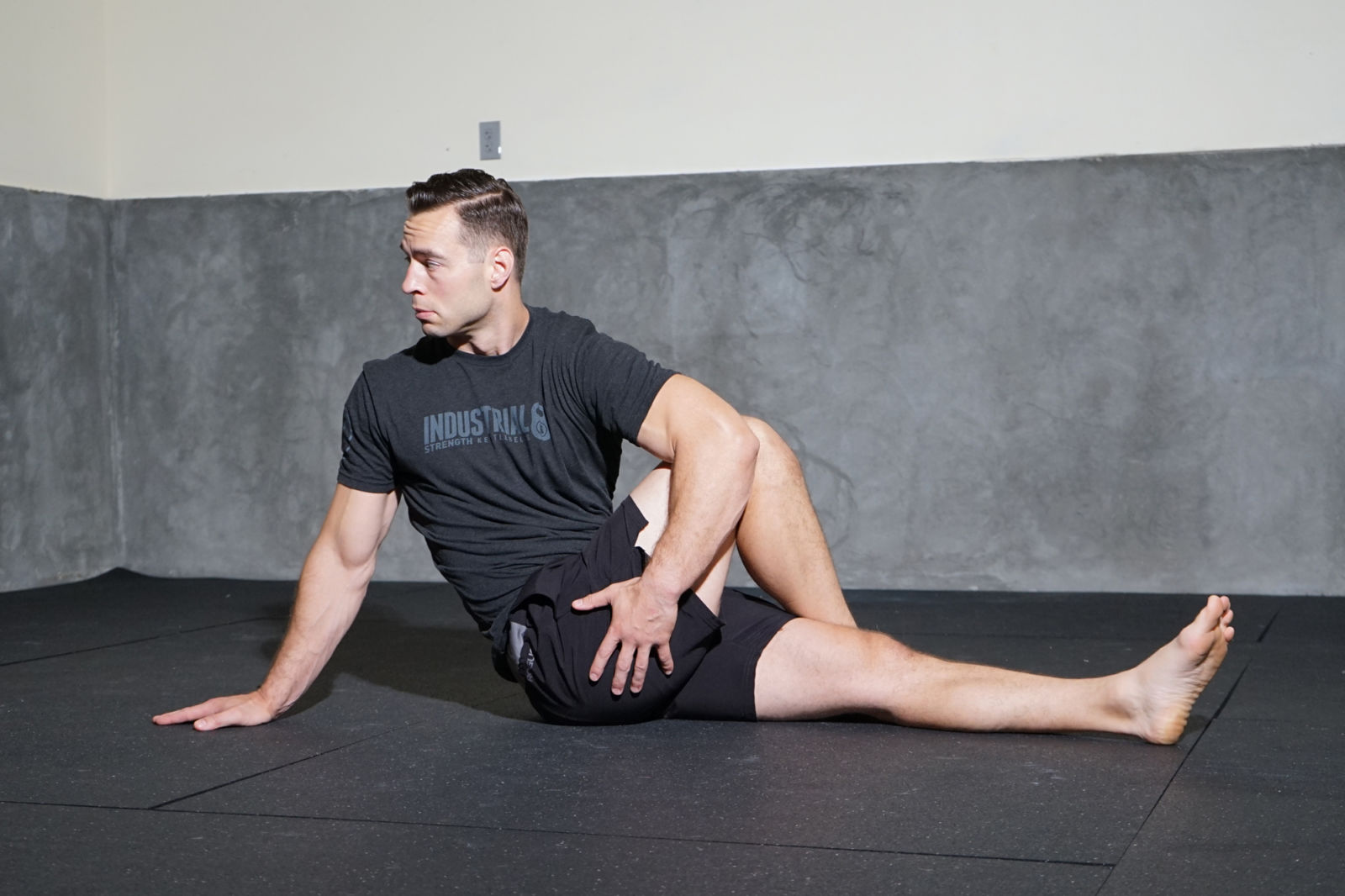 man doing a seated spinal twist