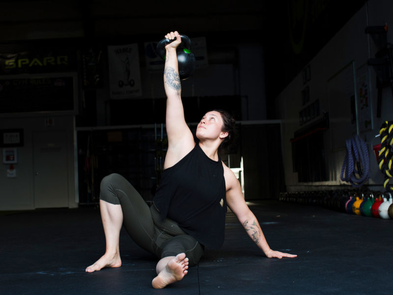 Woman doing a Turkish Get-Up with a kettlebell